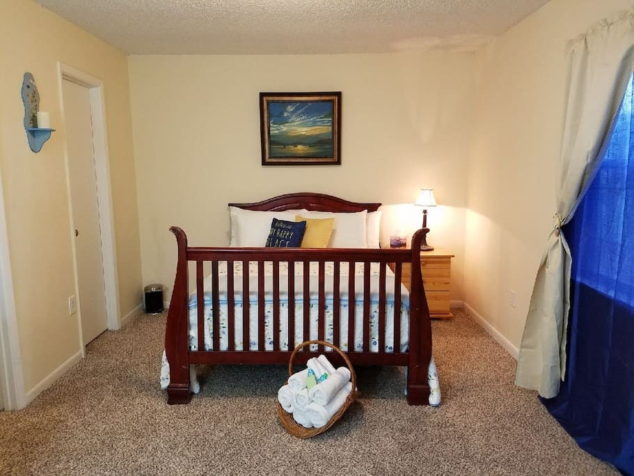Bedroom-  Queen size bed, walk-in closet with hangers, Iron and ironing board