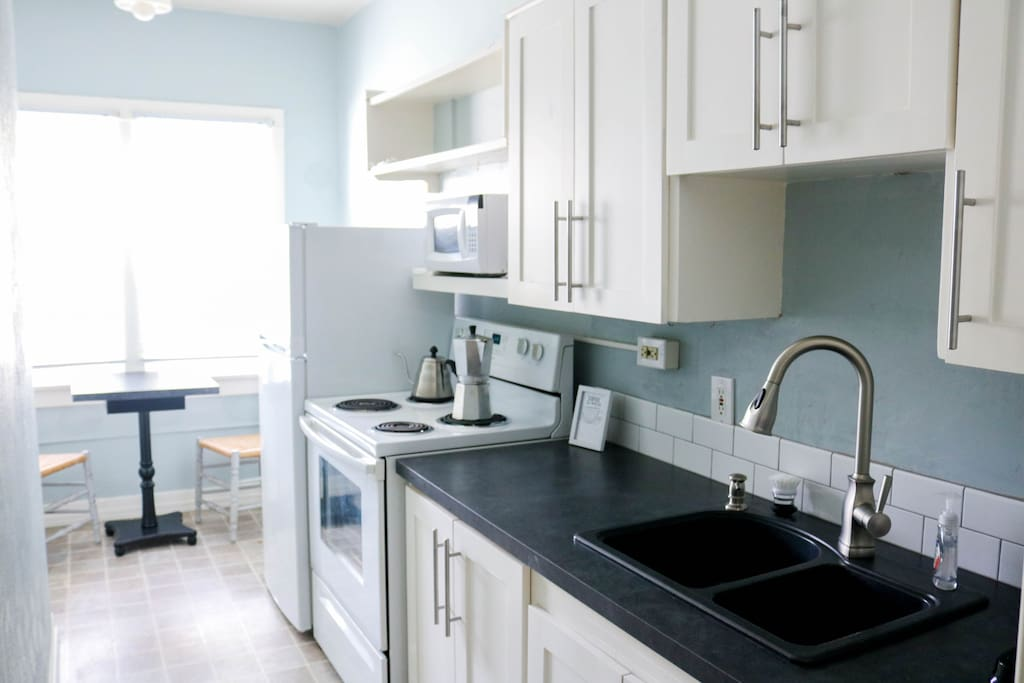 Sparkling clean, the kitchen provides the perfect spot to make a delicious meal.