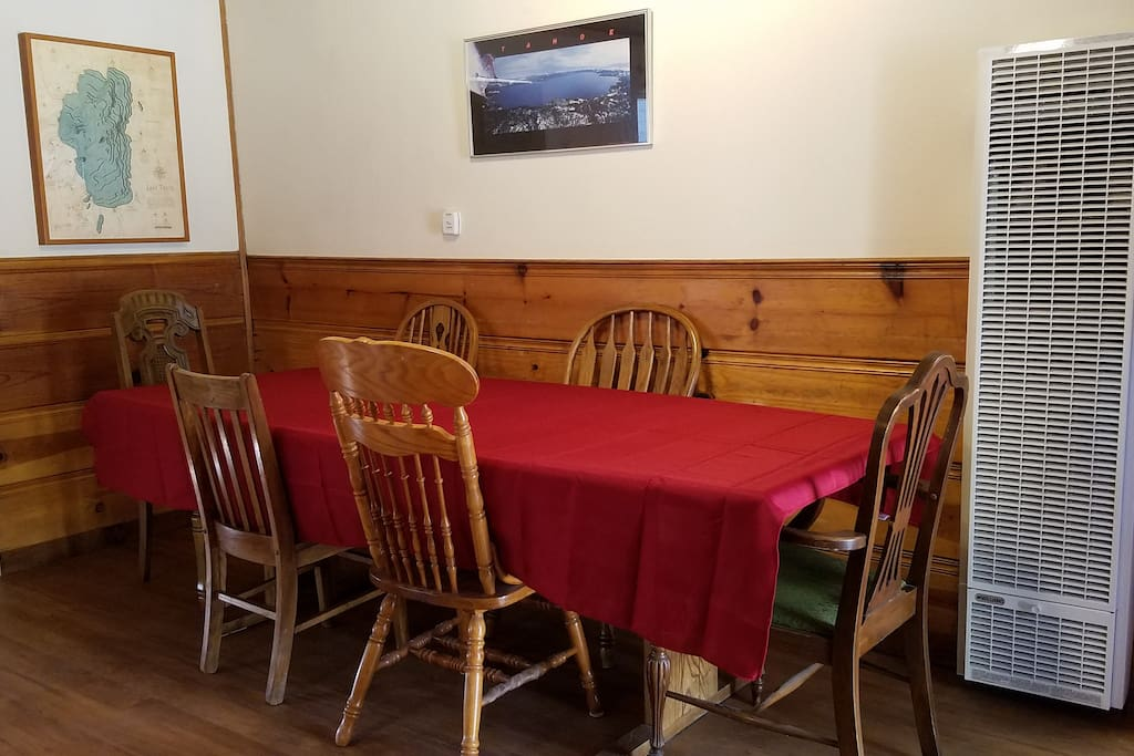 Dining Room: Enjoy a banquet size table with 6 chairs (plus two folding chairs). Great for big family dinners.