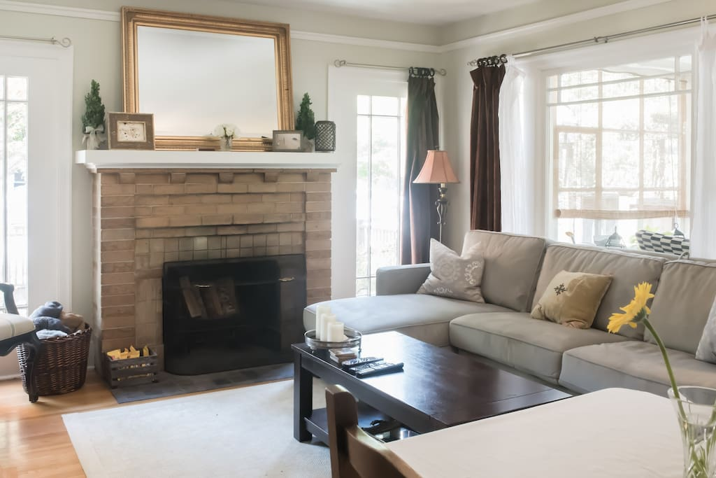 Spacious private living room space with a comfy, easy pull out queen sized couch for extra guests- for 2! Original 1920 windows, molding, lighting and flooring at this Old World Charm.