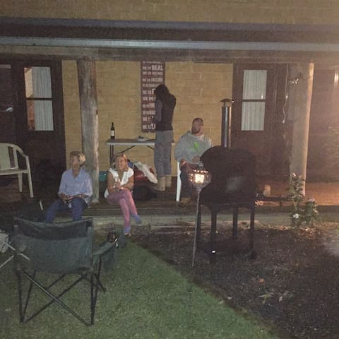 A relaxing evening on the front porch after a busy day. Wine with home made pizzas cooked in the wood fire oven for dinner.