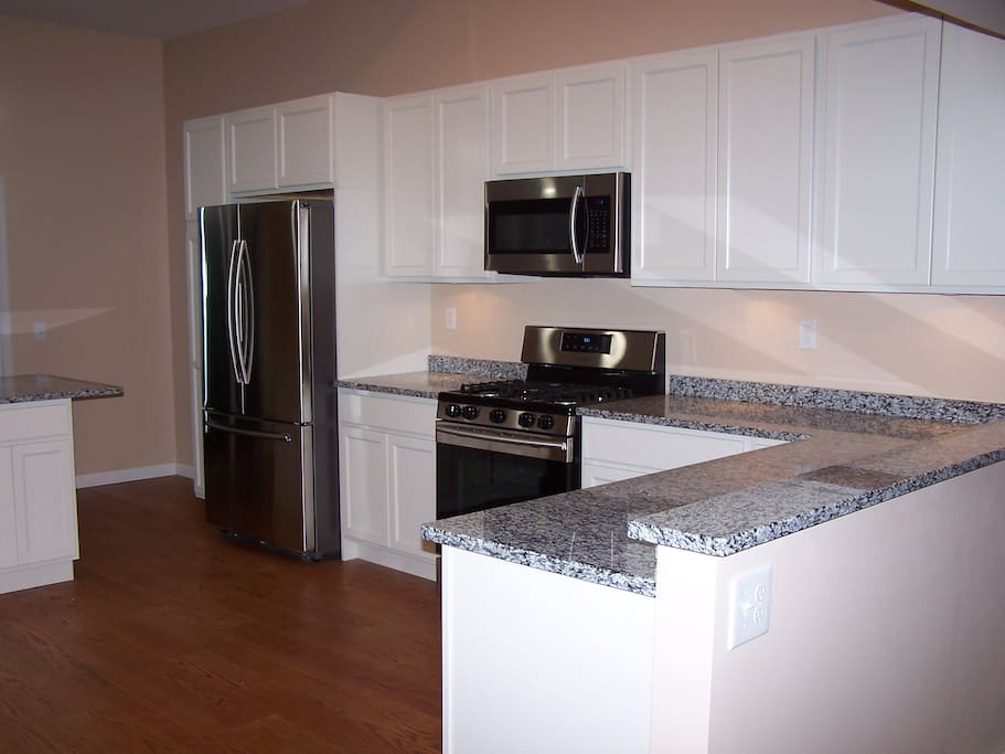 Huge kitchen with counter island.