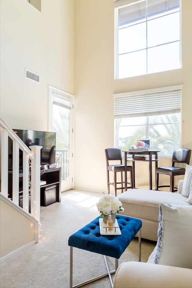 High ceilings and door to patio space
