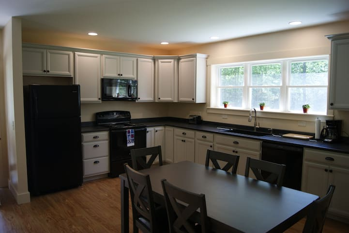Kitchen with refrigerator, stove/oven, microwave and dishwasher