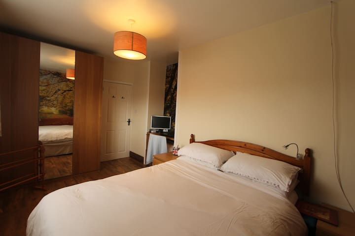 Double bed, space to store your things on the floor, clothes hanger for your use, hooks on back of the door for your use