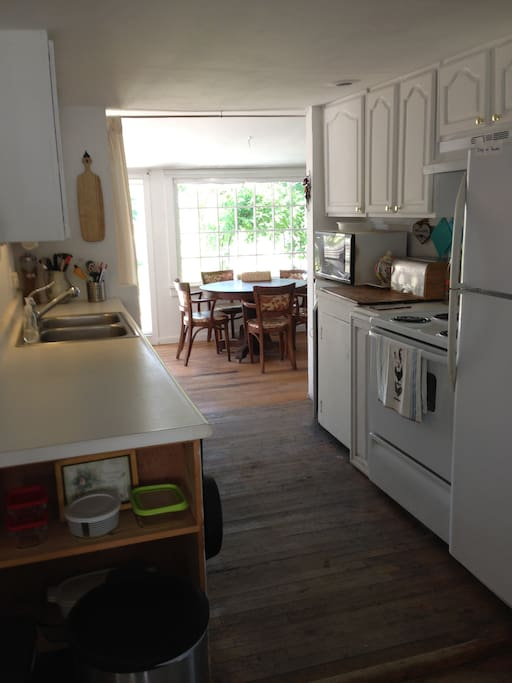 Kitchen with garden room eating area.