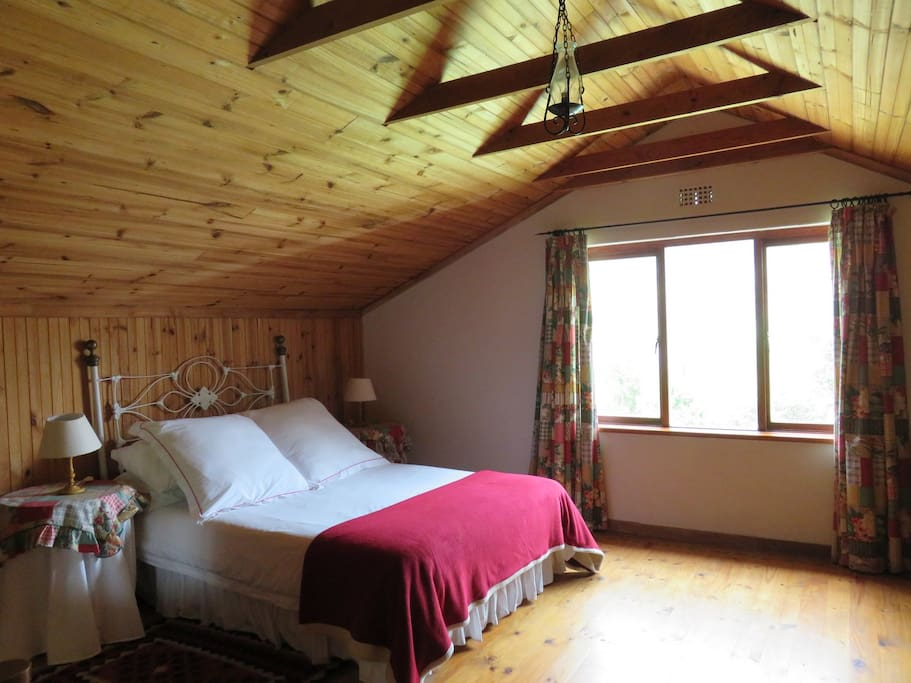 large woody loft 40m square with a double bed, wardrobe, dressing table.