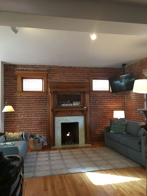Main room with fireplace, sleeper sofa, and tv