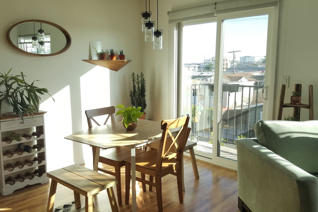 Sunny kitchen with balcony access - great for enjoying breakfast and a cup of coffee.