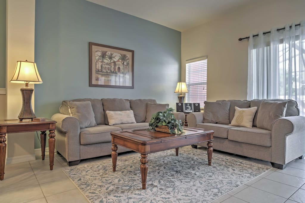 Kick back and relax on the cozy couches in the living room.