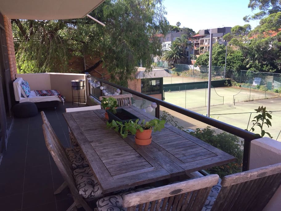 Wrap around balcony with day bed, dining area and BBQ