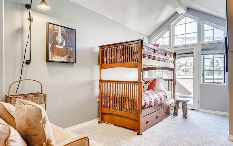 Bunk Room features a twin bunk bed, plus twin trundle at the base of the bunk bed. There is also a pull-out sofa with a twin bed. This bunk room sleeps 4.