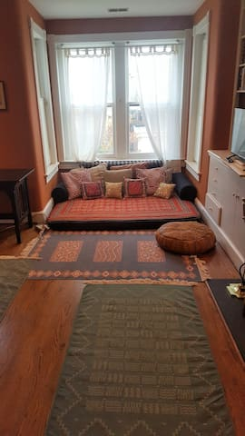 Comfy, pillow laden mat for reading or sleeping