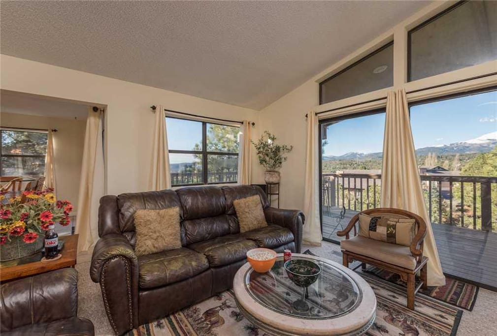 Easy Access - The living room provides quick and easy access to the outside deck where you can sit and enjoy the cool breeze and