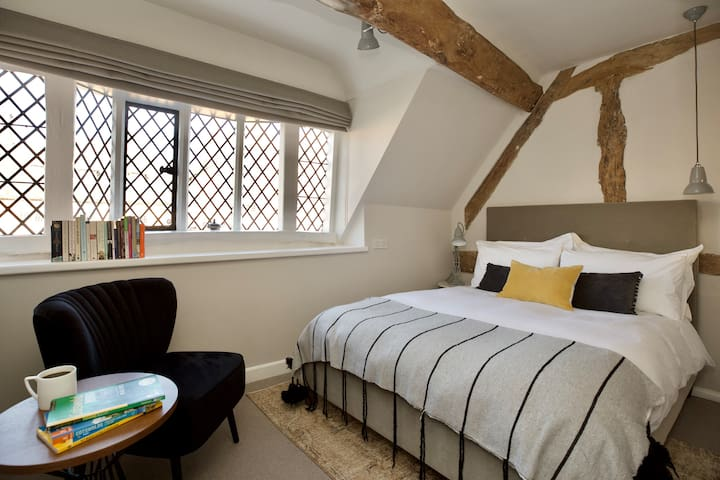 The second bedroom with oriel window overlooking the High Street - great for watching life go by