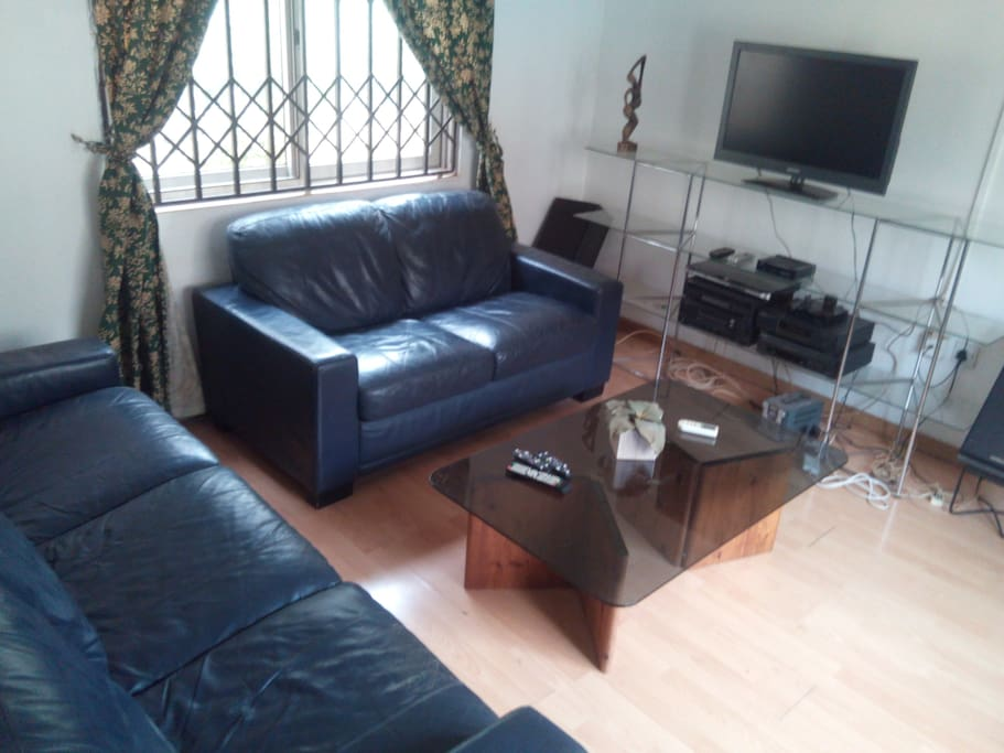 Furnished lounge with TV with multi channel and contemporary standards.