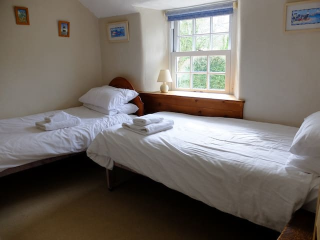 Bed 2 - Twin beds with Hanging space and shelves in alcove to left of shot (but not visible)