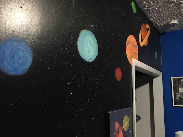 Simply STELLAR outer space themed guest room!