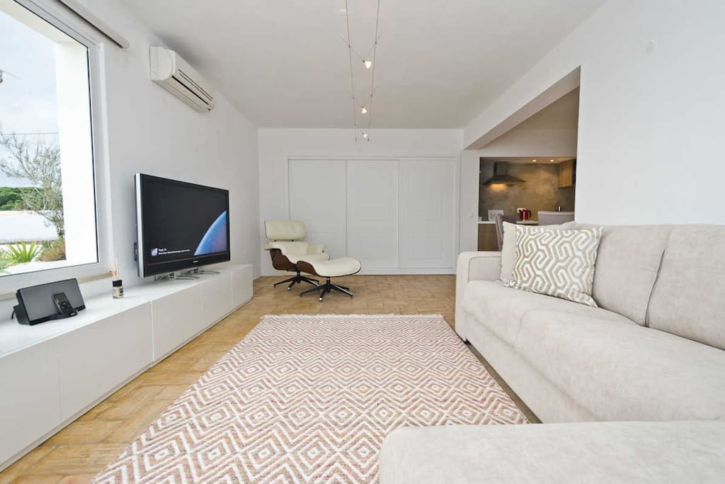 Modern living room combining modern & traditional features where you will find 127cm flat TV, Playstation and iPod