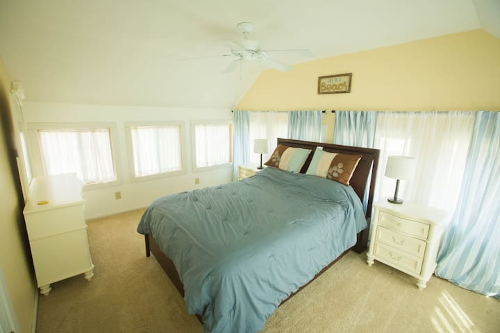 Our master bedroom is surrounded by windows and has an excellent view of the lake!
