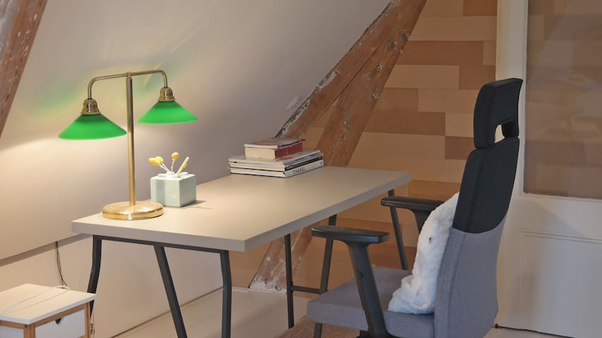 [Your bedroom] An office table for laptop.