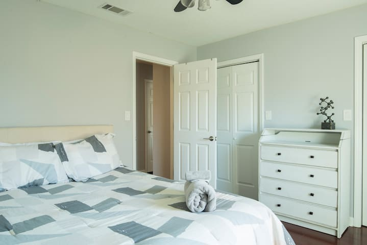 Queen sized bed and 2 closets for additional guests.