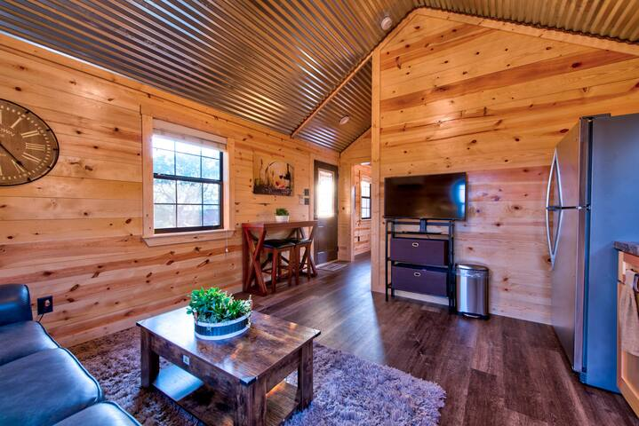 We provide free extremely high speed WIFI.  This way you can stream on our smart television without any glitching.  We offer a full google nesting system that provides additional entertainment.  As you can see the cabin is very roomy.