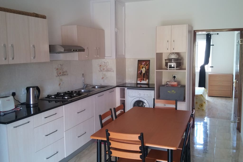 Fully Equipped Kitchen and Dinning Room - Washing Machine  - Fridge / Freezer, Kitchen cooking utensils, microwave, kettle, toaster, cooker, ...  Dinning Table with 6 chairs  Plus another external table with 4 chairs for the porch / balcony