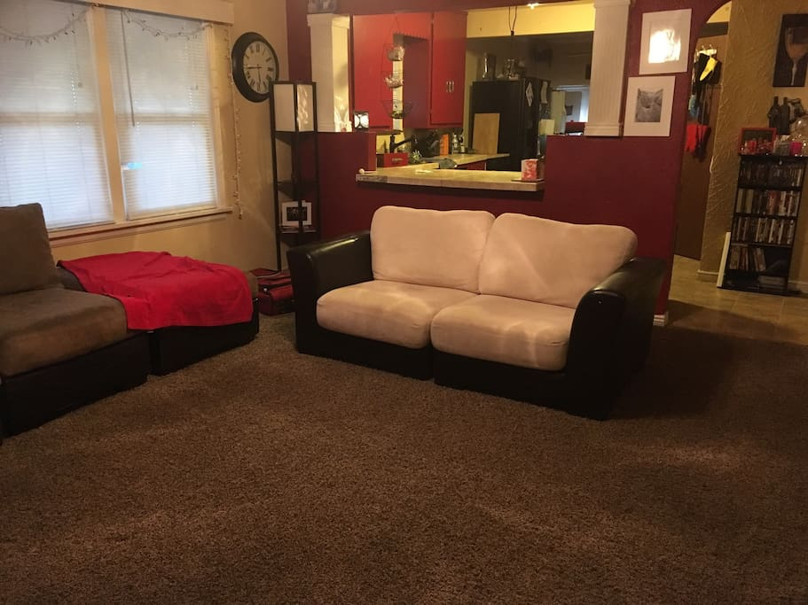 Spacious living room with comfy couches. Equipped with a PlayStation 3 and Netflix.