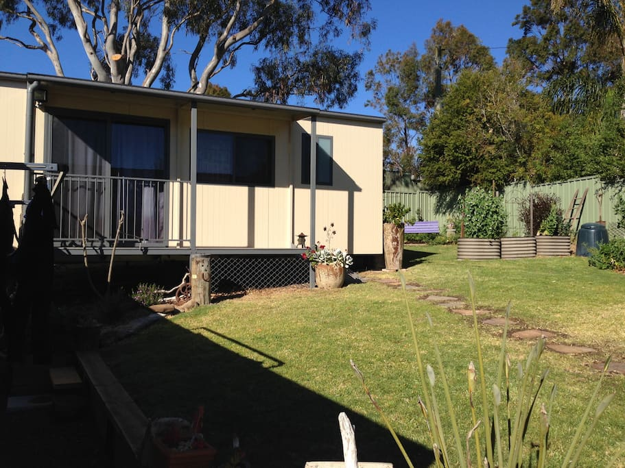 Totally self-contained and located at the back of the property with parking on site