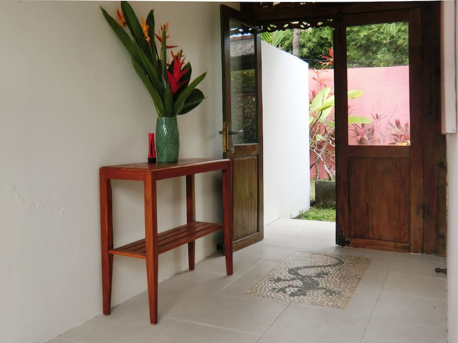 A welcoming reception area greets guests inside the front door of the villa.