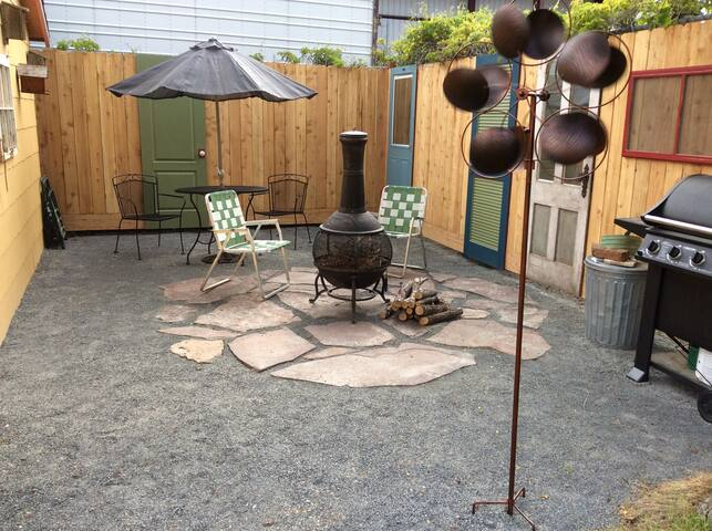 Lighted patio with gas grill and chimenea.