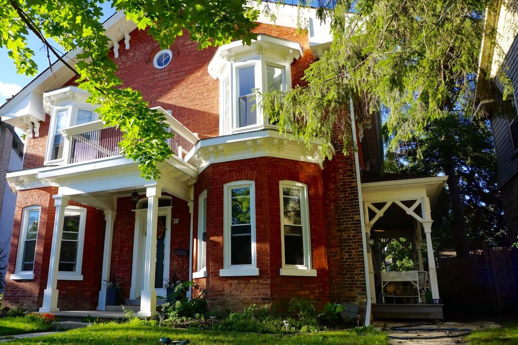 Beautifully restored red brick home with tons of character (it dates back to the 1850's)! It was built and used as a church until the turn of the 20th century and you can see the outline of where the two story windows once were on the sides. Beautiful carved wood corbels and side porch, deep windows and huge baseboards throughout.