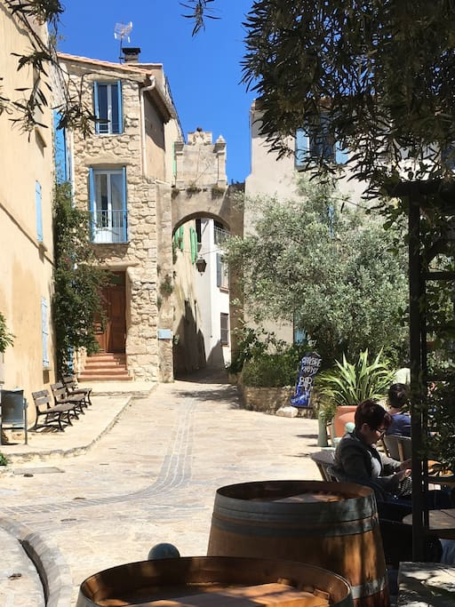 The main village square in Bages. Our house is the one in stone to the left of the arch and sundial