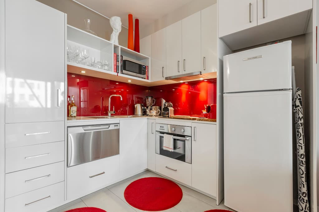Sparkling clean kitchen with every appliance, and a stocked pantry and fridge
