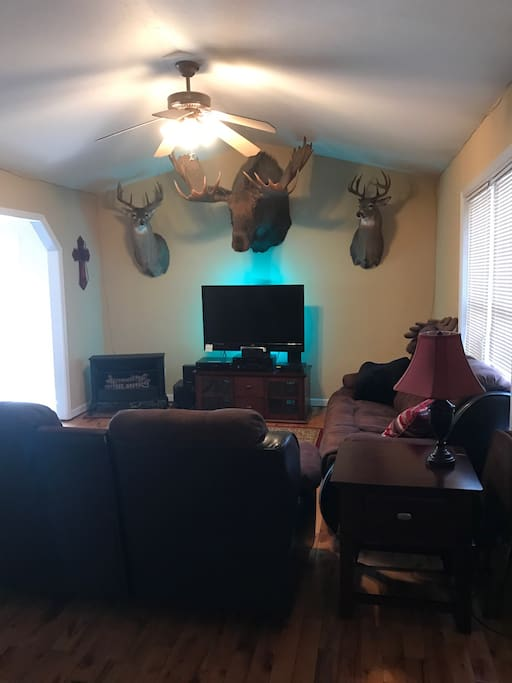 Our comfortable living room will sit 5. Four of the seats will recline. You can lay back and enjoy watching satellite tv (or just stare at the moose).