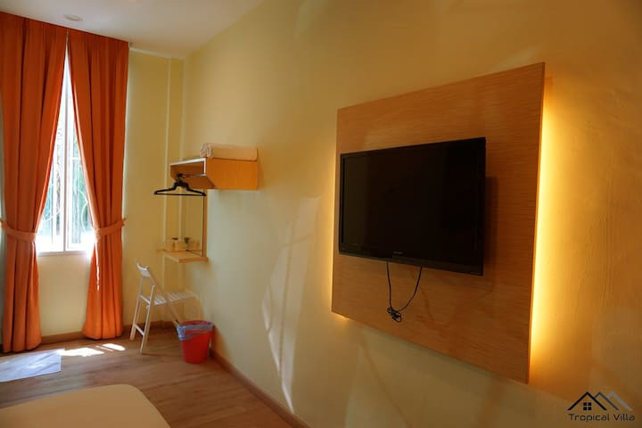 """Facilities in the room: Attached private bathroom , LCD 32"""" television with Astro channels , Adjustable air-conditional , Individual dressing table , Cloth Hangers , Towels"""