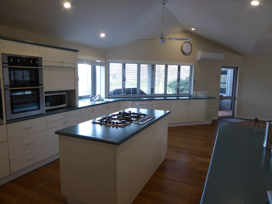 3 wall ovens, 5 gas hobs, 2 fridge freezers