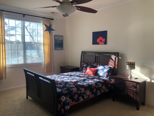 Master bedroom on 2nd floor with view of lake. Queen size bed.