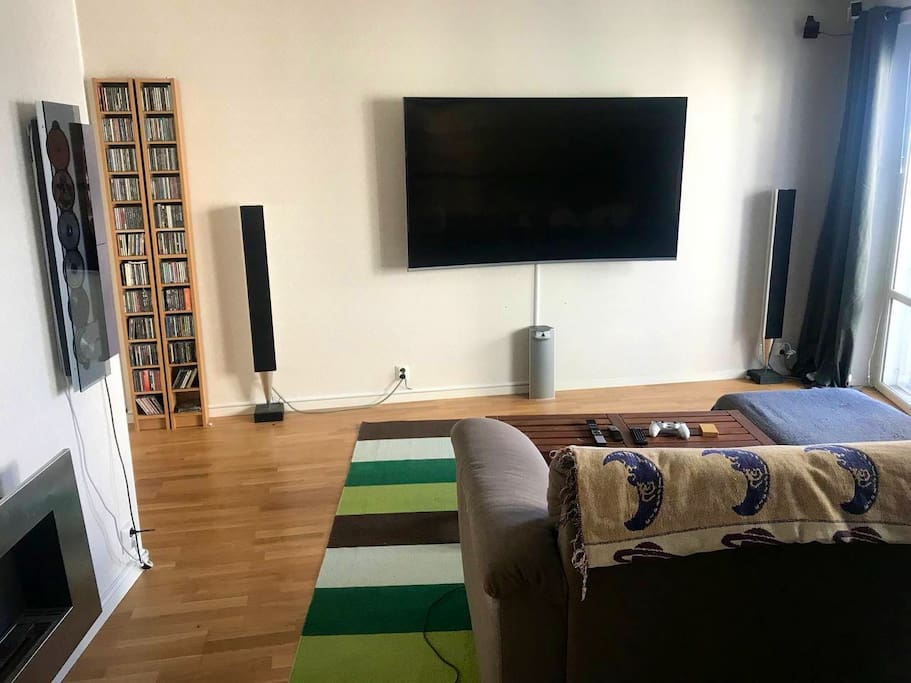 """Livingroom with 78"""" Screen, Bang&Olufsen Home Theatre Surround Sound"""