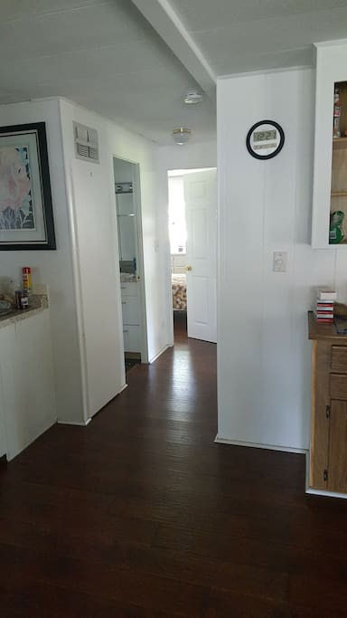 hallway to bedroom and bathroom