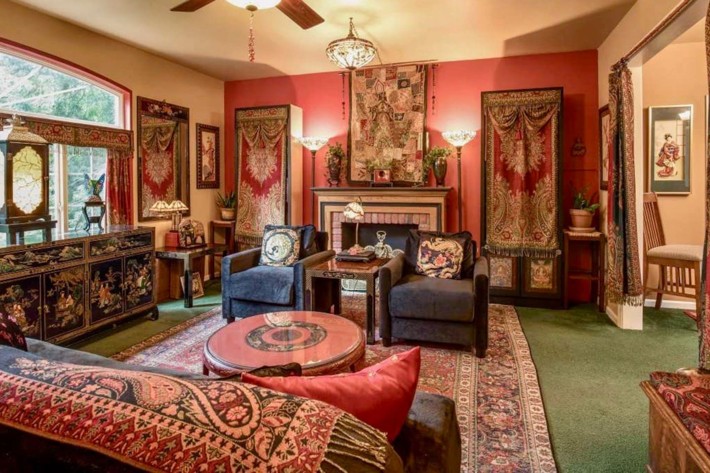 The front room welcomes you with light, warmth, comfort, books, & TV (behind the tapestries)...enjoy everything from robust conversations to meaningful quiet time, from browsing though the library to gazing at rich greenery in temperate comfort! :-)