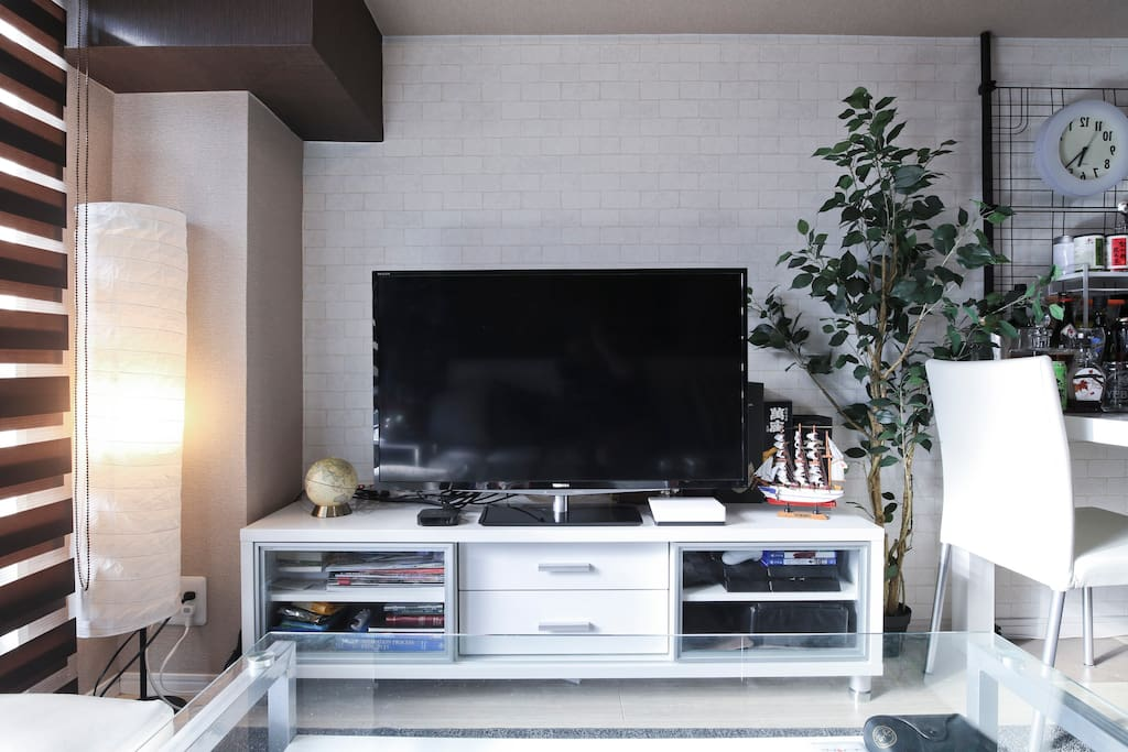 40-inch LED TV, connected to an Apple TV so you can watch you favorite shows from home (Hulu, Youtube, etc) or directly from your Mac.