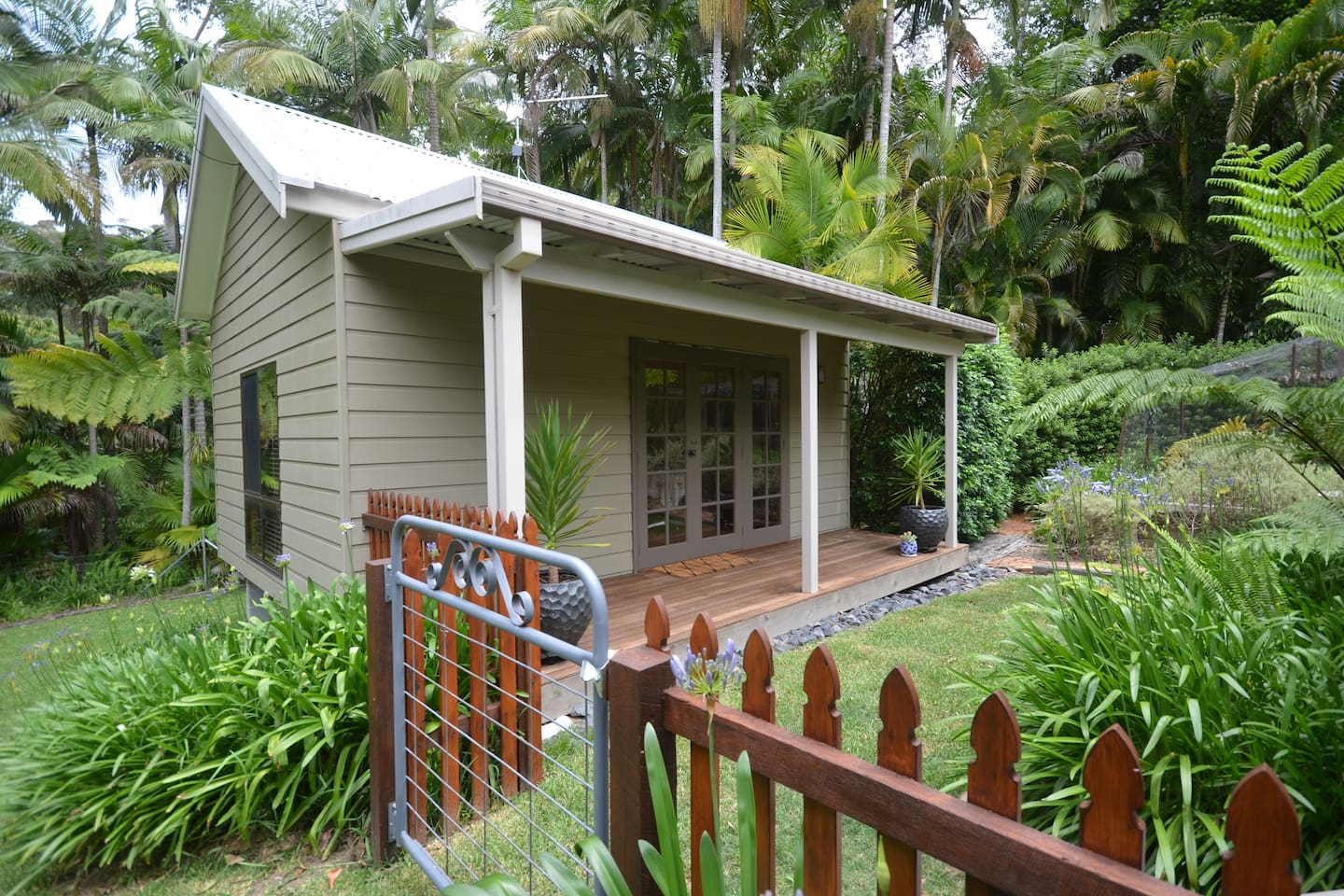 The cottage is a few metres away from the main residence. The French doors have a blind which can be drawn at night for privacy.
