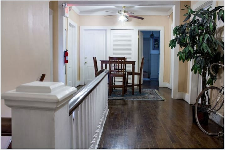 2nd Floor Common Area - Kitchen is located thru the open door to the Right