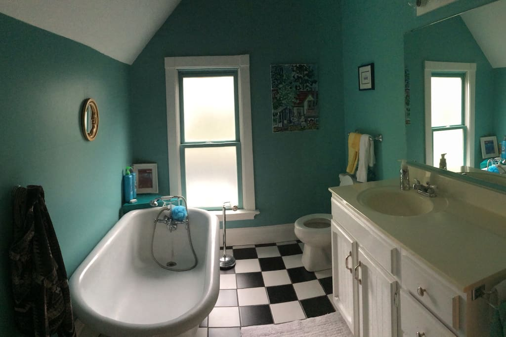 Upstairs full bath with original restored claw foot rub. Great for relaxing in deep hot bubble bath.