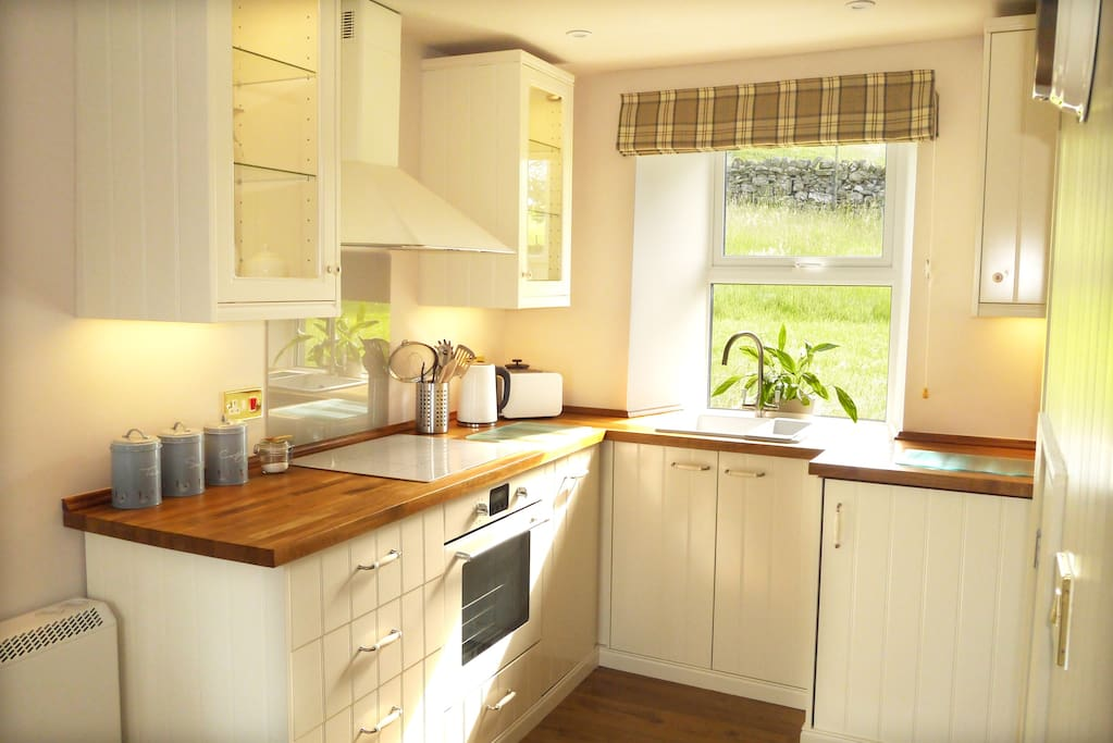 Kitchen with fridge freezer, washer/dryer and dishwasher.