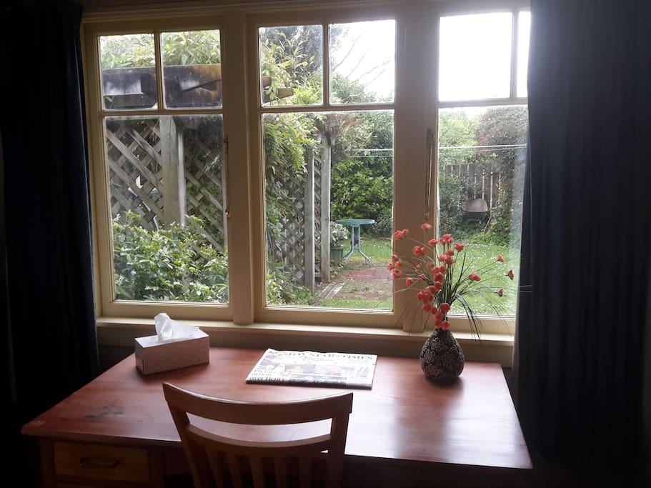Window overlooks small garden, lovely suntrap, wooden lattice and climbing greenery provides privacy.