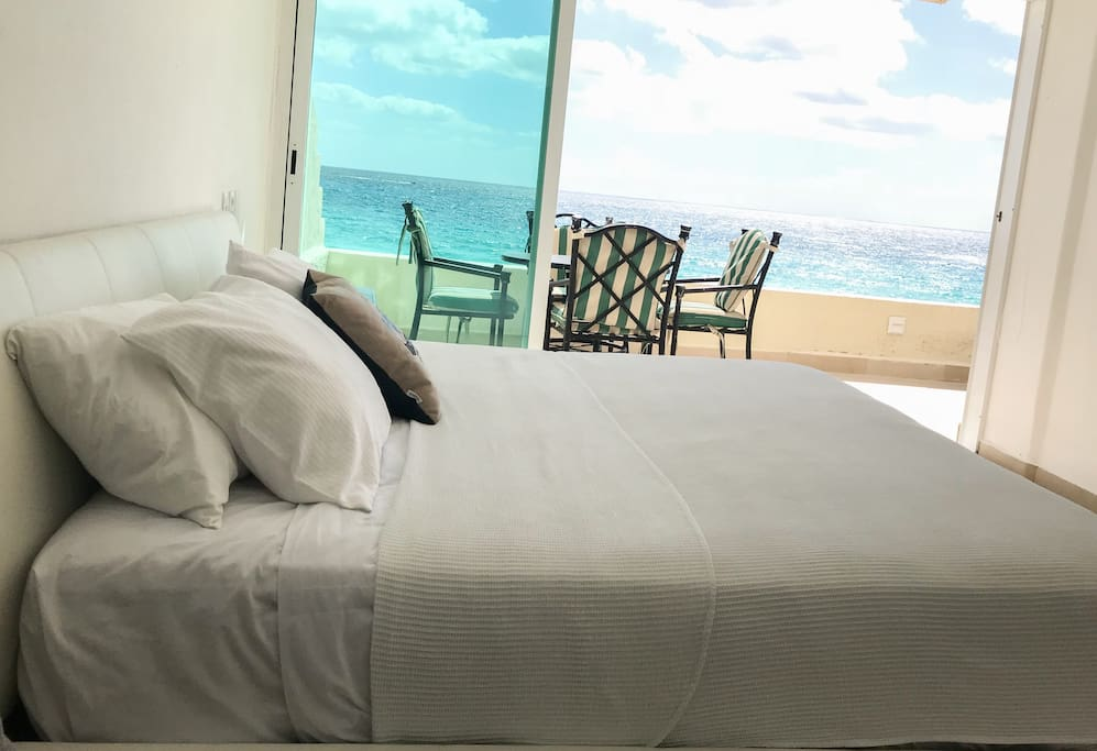 Wake up on this king size bed every morning overlooking the ocean.