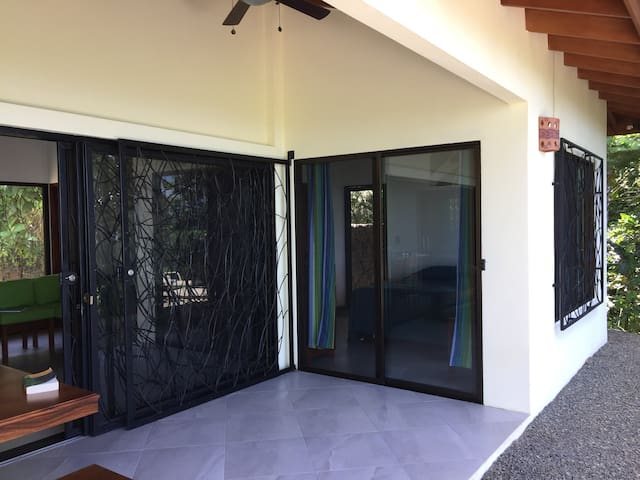 From the Master Bedroom you can walk out to the terrace and to the rancho projecting out over the hillside or to your grill / smoker.